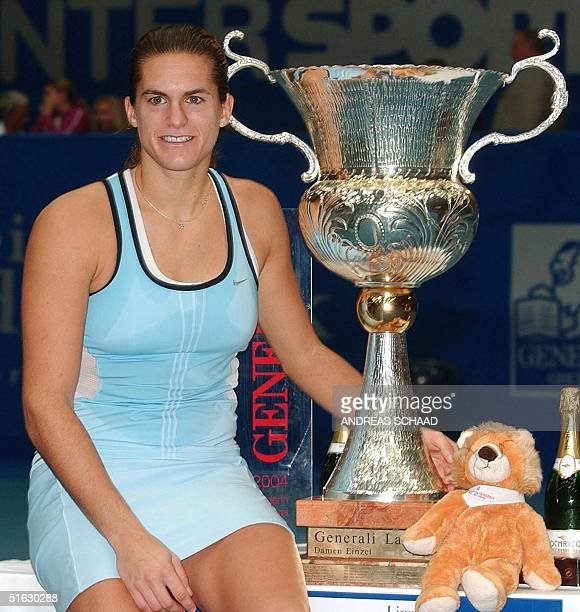 French Amelie Mauresmo poses next to the winner's trophy after defeating Russian Elena Bovina in their final match at the Linz WTA 460, 000 Euros...