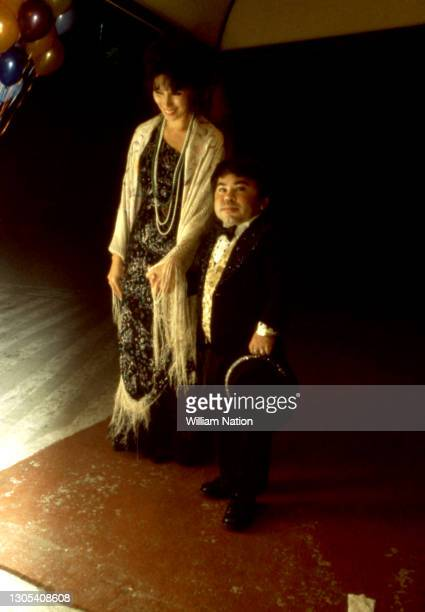 French American actor Hervé Jean-Pierre Villechaize poses for a portrait with a friend circa April, 1983 in Los Angeles, California.