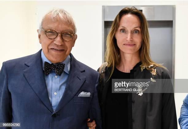French American environmental artist Anne de Carbuccia poses with her lawyer JeanPierre Versini Campinchi as they arrive at Paris courthouse on July...