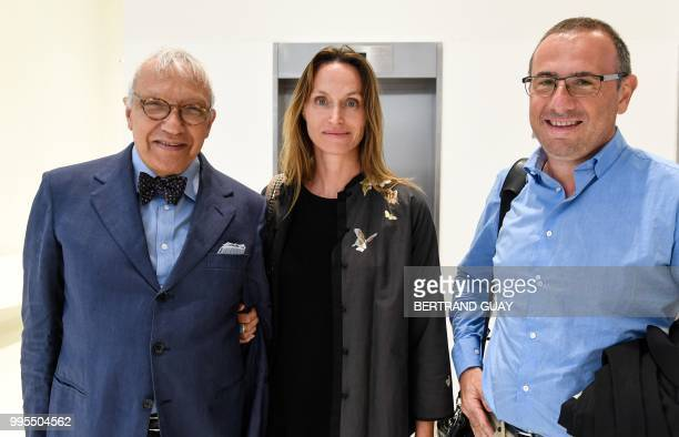 French American environmental artist Anne de Carbuccia poses with her lawyer JeanPierre Versini Campinchi and Marc Maroselli as they arrive at Paris...
