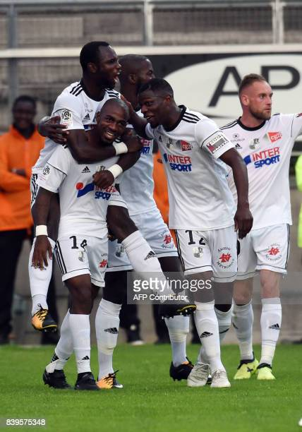 French Amiens' Gael Kakuta is congratuled by teammates after scoring during the French Ligue1 football match between Amiens and Nice on August 26...
