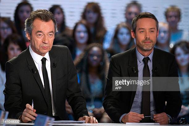 French anchormen Yann Barthes and Michel Denisot are pictured during a TV broadcast show 'Le Grand Journal' on Canal Plus channel on March 9 2012 in...