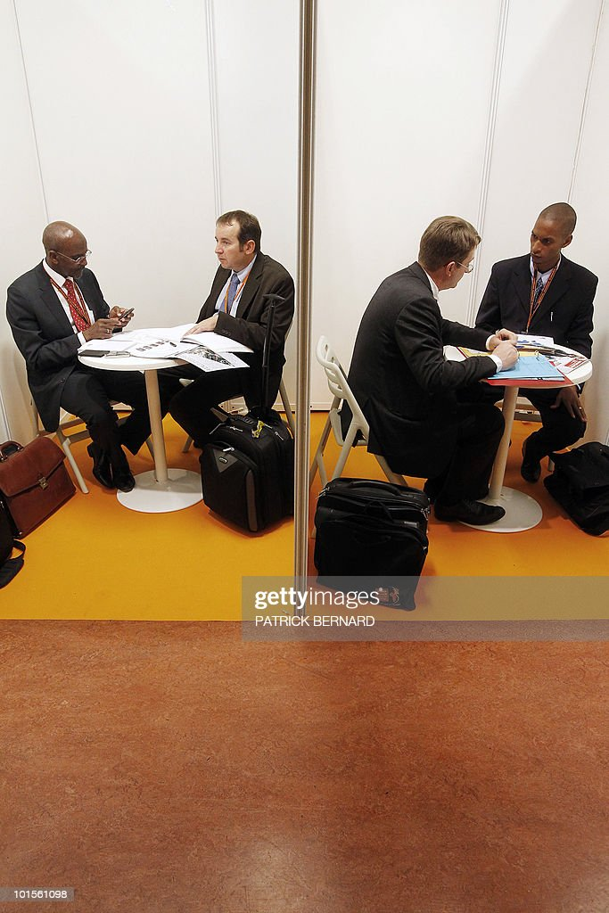 French and African economic representatives chat on the issue of 'speed dating' focusing on business on June 2, 2010 during the 2nd 'Africa France Business Meetings' held in Bordeaux, southwerstern France. Representatives of 26 African countries will meet business leaders of 70 French companies for a limited 20 minute roundtable at the end of the 25th Africa-France Summit, in Nice, southern France.