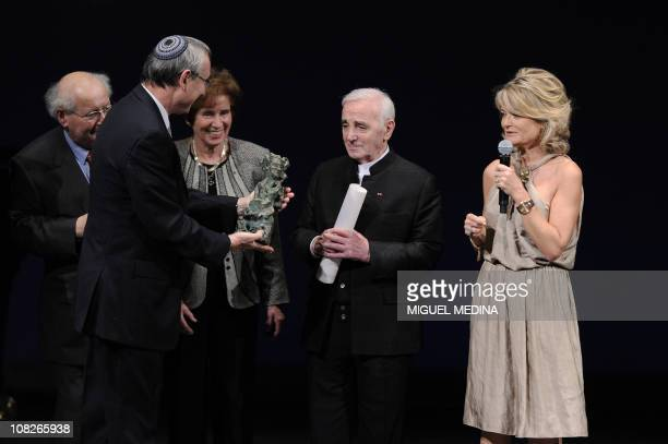 French and Armenianborn singer Charles Aznavour receives the 2011 Scopus Award from Menahem Ben Sasson President of Jerusalem hebraic University as...