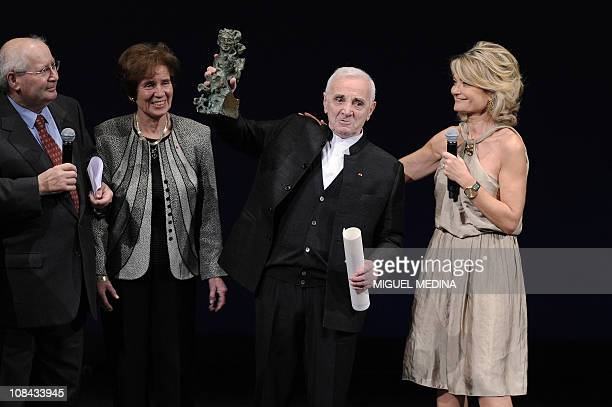 French and Armenianborn singer Charles Aznavour waves his sculpture designed by Gerard Garouste after receiving the 2011 Scopus Award as Beate and...