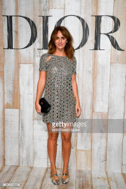 French and Brazilian socialite Alexia Niedzielski poses during the photocall before the 2019 Dior Croisiere fashion show on May 25 2018 at the...