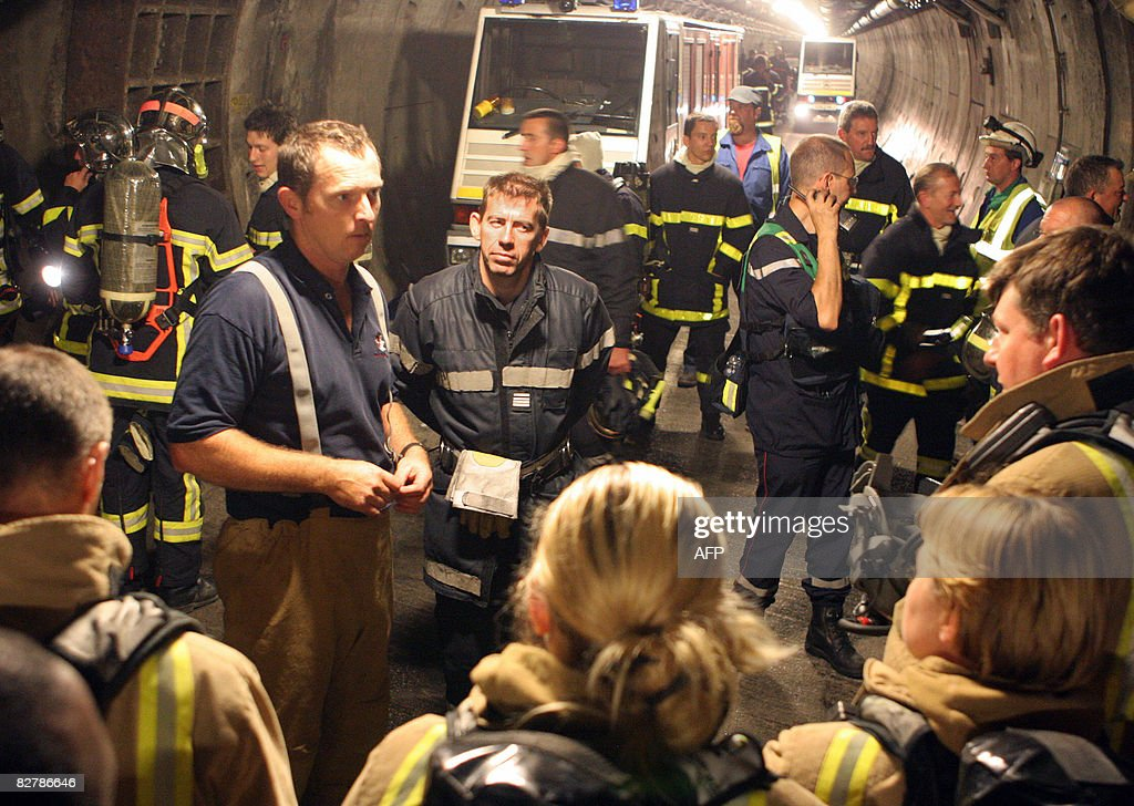 French and British firemen get ready early on September 12, 2008 in the maintenance tunnel to battle the fire that broke out in the Channel tunnel on a freight shuttle. French and British Firefighters slowly mastered after 15 hours a 1,000 degree inferno in the Channel Tunnel but tens of thousands of travellers faced extended disruption. Thirty-two truck drivers on the shuttle smashed windows on the shuttle to escape and get into the service tunnel from they were evacuated. Six people were injured in the third major blaze since the tunnel under the Channel opened in May 1994.
