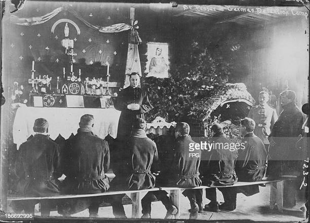 French and British prisoners of war holding mass in a German camp during World War One Germany circa 19141919