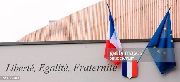 French and European flags hang next to the French national motto 'Liberty equality fraternity' at the Saint Exupery School in Hellemmes near Lille on...