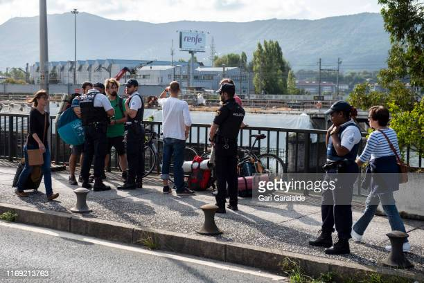 French and Spanish police stand at a security checkpoint on the SaintJacques bridge between Hendaye and Irun at the Spanish french border on August...