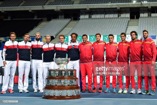 TOPSHOT French and Spanish tennis players pose for photographers behind the Davis Cup on September 13 2018 in Villeneuved'Ascq northern France after...