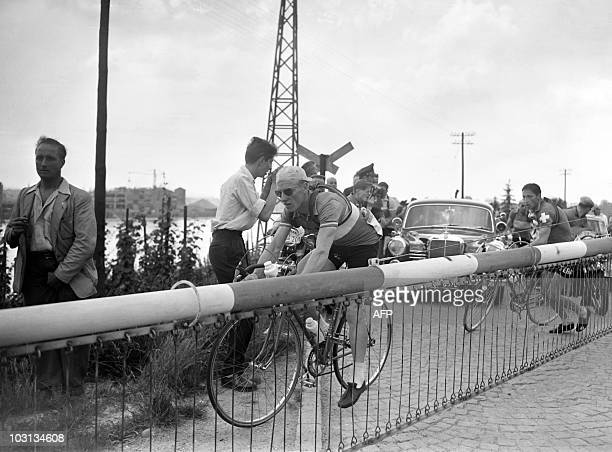 French Andre Darrigade and Swiss Ferdi Kubler pass the level crossing of Grenzach during the 6th stage of the Tour de France 1955 between...