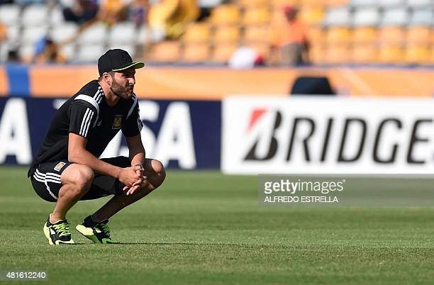 French AndrePierre Gignac of Mexican Tigres team looks at the field before the Libertadores football match against Internacional of Brazil at...