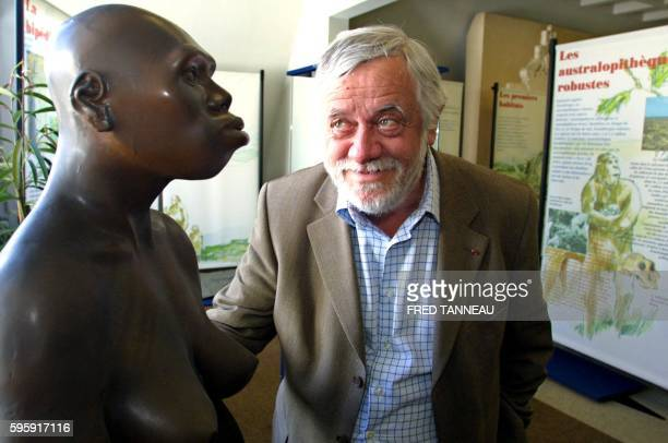French anthropologist Yves Coppens poses next to a model of Lucy a female australopithecus on July 10 2004 in Carnac as part of an exhibition Lucy in...