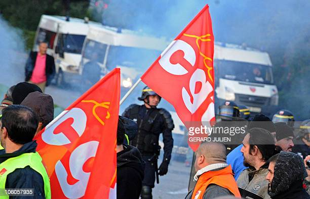 French anti riot policemen face strikers as they block access to Marseille's airport in the south of France on October 21, 2010 in Marignane, unions...