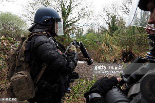 French anti-riot Gendarme loads a tear gas cannister into a Cougar MS grenade launcher as they confront protesters in the decade-old anti-capitalist...