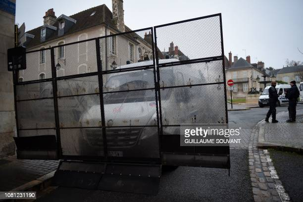 French antiriot police CRS stand guard by one of their vehicle equipped to form a dam in the streets of Bourges on January 12 2019 ahead of an...