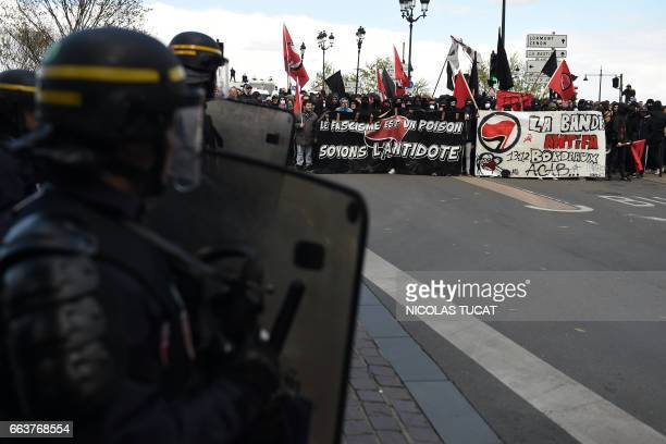 TOPSHOT French antiriot police look on during a demonstration against French farright candidate for the French presidential election Marine Le Pen as...