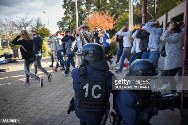 French antiriot police officers evacuate hostages during an exercise simulating a terrorist attack inside the theatre Espace Malraux in JouelesTours...