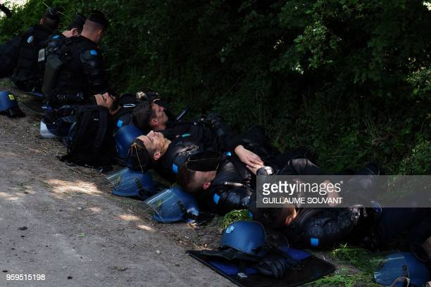 French antiriot police officials rest on a road prior to a second round of evictions of environmental protesters from a site known as ZAD of what had...