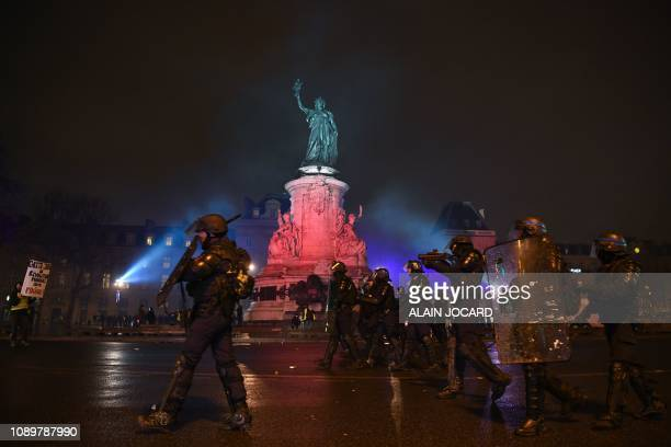 TOPSHOT French antiriot police walk in group on the place de la Republique in Paris during an antigovernment demonstration called by the Yellow Vests...