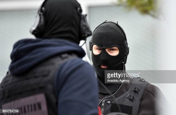 French antiterrorist force RAID operate at Orly Airport near Paris France on March 18 2017 following the shooting of a man by French security forces...