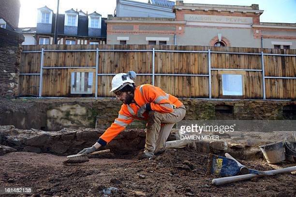 A French archaelogist of Inrap digs a 8000 SQM area on the site of a former convent on February 11 2013 in the city center of Rennes western France...