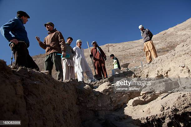 French archeologist Philippe Marquis discusses recent their finds with a colleague at Mes Ainak, an ancient Buddhist settlement 35km south of Kabul,...