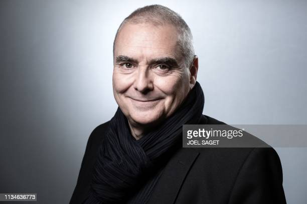 French architect Dominique Perrault, who created the model of the Olympic Athletes Village of the Paris 2024 Olympic Games, poses during a photo...