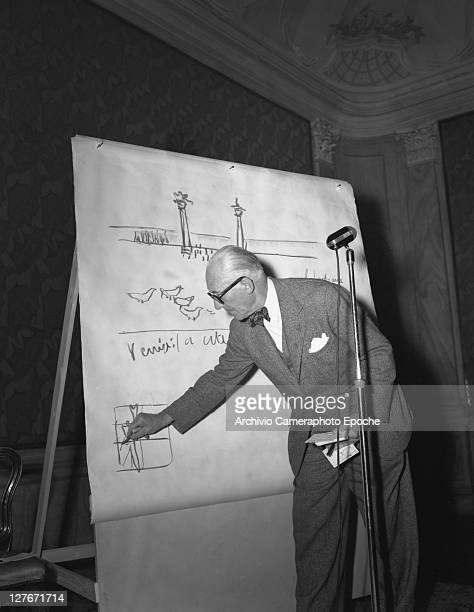 French architect Le Corbusier drawing on a blackboard Venice 1965