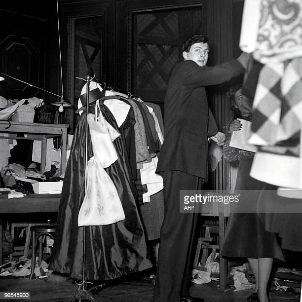 French aristocrat and fashion designer Hubert de Givenchy waits backstage during the 1952 spring/summer collection on February 2 1952 in Paris AFP...