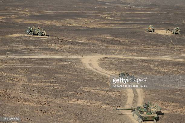 French armored vehicles patrol on March 17 2013 in the Adrar of the Ifoghas mountain range in northern Mali AFP PHOTO / KENZO TRIBOUILLARD