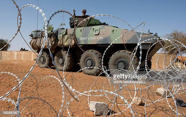 A French armoured personnel carrier is stationed at a checkpoint guarding access to the airport at Gao on March 9 where French forces haves...