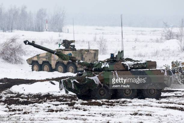French armoured reconnaissance tank AMX 10 RC and a German Boxer armoured personnel carriers take position during the GermanFrench armed forces...