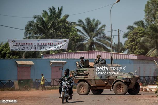 French armoured vehicle of the SANGARIS contingent patrols in the area where sporadic gunfire and improvised barricades closed the access to some...