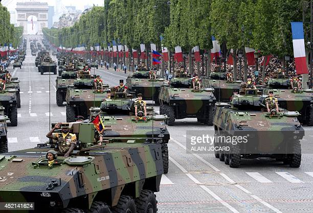 French Army armoured vehicles of the 92nd Infantry Regiment drive down the ChampsElysees avenue in Paris during the annual Bastille Day military...