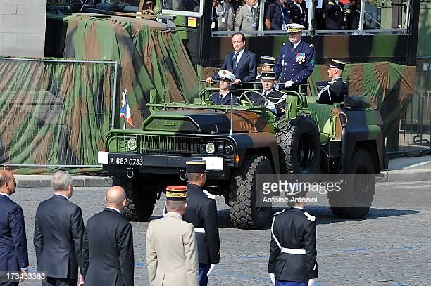 French Army Chief of Staff Admiral Edouard Guillaud and French President Francois Hollande arrive at the Bastille Day parade on the Champs Elysees on...