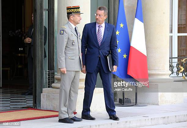 French Army Chief of Staff General Pierre de Villiers and Head of French Intelligence Services Bernard Bajolet attend an extraordinary defense...