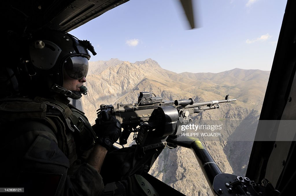 A French army helicopter door gunner is pictured during the flight carrying Franceu0027s President Nicolas Sarkozy & A French army helicopter door gunner is Pictures | Getty Images pezcame.com
