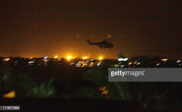 A French army helicopter takes part in a night operation to evacuate Japan's ambassador to Ivory Coast Okamura Yoshifumi from his besieged embassy in...