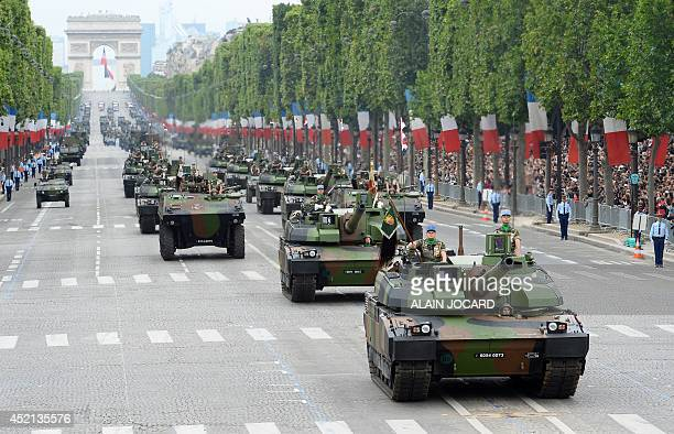 French Army Leclerc tanks of the 1st Regiment of Chasseurs drive down the ChampsElysees avenue during the annual Bastille Day military parade in...