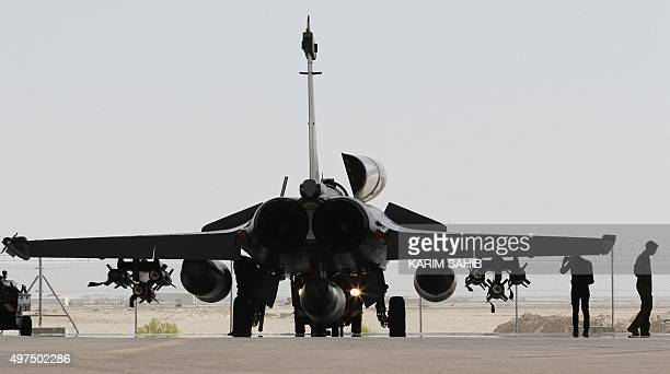 A French army Rafale fighter jet sits on the tarmac at a military base at an undisclosed location in the Gulf on November 17 as the French army...