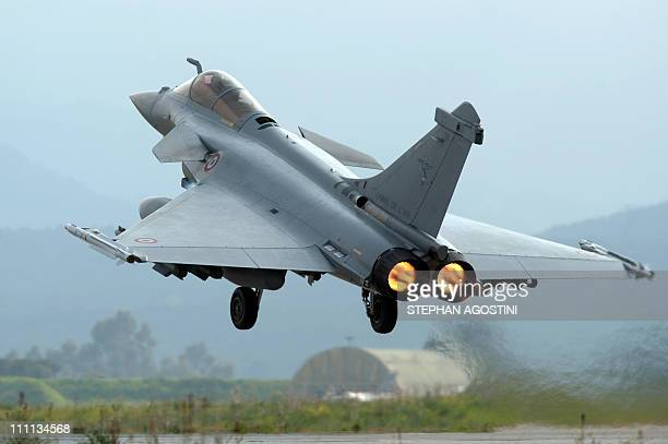 A French army Rafale jet fighter takes off on March 26 at the aerial military base 126 Capitaine Preziosi aka Solenzara base in Ventiseri on the...