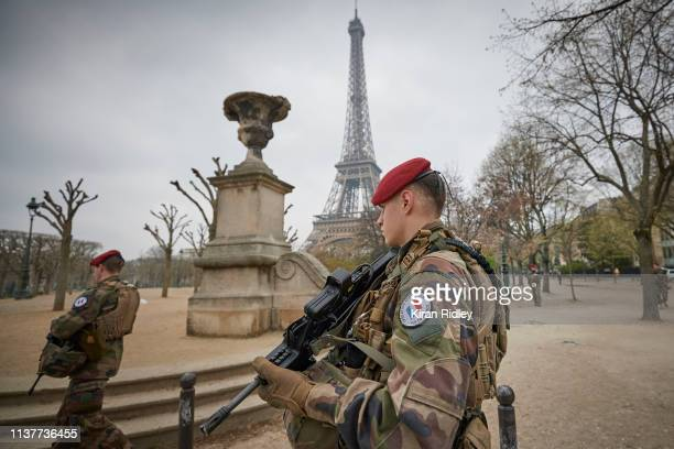 French Army soldiers of Operation Sentinelle patrol around the Eiffel Tower during Act 19 of Gilets Jaunes or 'Yellow Vest' protests on March 23 2019...