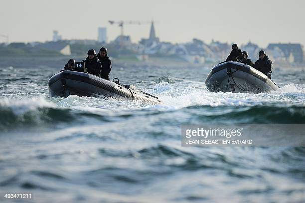 GAUVRY French army Special Force commando soldiers approach a ferry between Lorient and the Island of Groix with their semirigid boats during a...