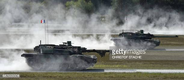 French army tanks type 'Leclerc' drive during a first shooting of the exercise 'Strong Europe Tank Challenge 2017' at the exercise area in...