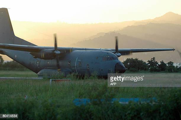 A French army Transal with some 90 gendarmes and policemen lands on March 27 2008 at the airport in Pamandzi Petite Terre part of the French island...