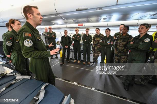 French army's medical personnel in the French army's medicalized Airbus A330 prepare before taking off on March 31, 2020 from the Istres military...