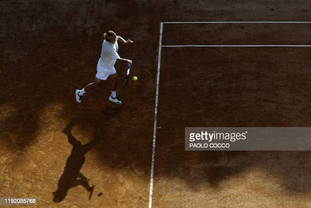 French Arnaud Clement returns the ball to Italian Davide Sanguinetti during the first round of the tennis Rome Masters Series 05 May 2003 at the Foro...