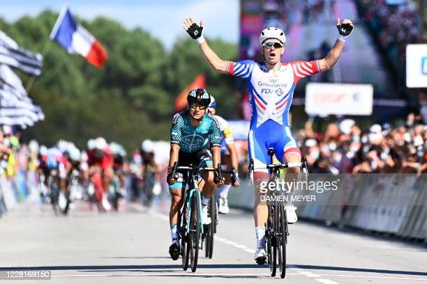 French Arnaud Demare celebrates as he crosses the finish line and wins the French Elite men road cycling championship in Grand Champ, western France...